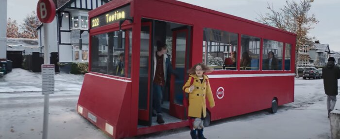 Screenshot from the John Lewis advert of a girl getting off a bus